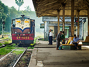 25 NOVEMBER 2017 - YANGON, MYANMAR: A train engine in the Yangon Central Railroad Station. The Yangon Circular Train is a 45.9-kilometre (28.5 mi) 39-station two track loop system connects satellite towns and suburban areas to downtown. The train was built during the British colonial period, the second track was built in 1954. Trains currently run both directions (clockwise and counter-clockwise) around the city. The trains are the least expensive way to get across Yangon and they are very popular with Yangon's working class. About 100,000 people ride the train every day. A a ticket costs 200 Kyat (about .17¢ US) for the entire 28.5 mile loop.    PHOTO BY JACK KURTZ