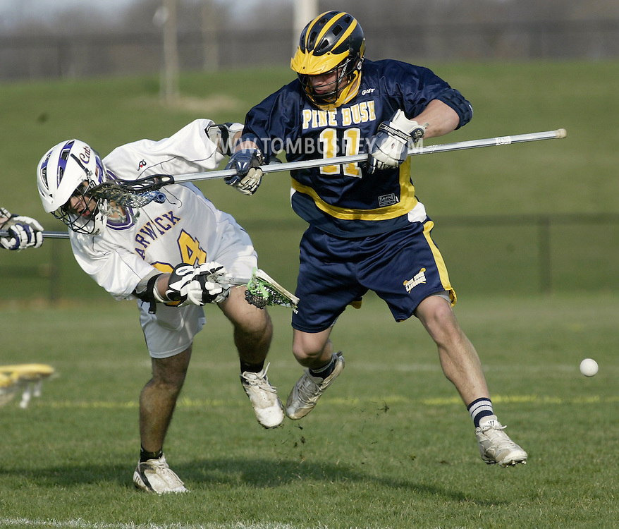 Pine Bush's Shaun Eichner, right, collides with Warwick's Armand Rivera during a game in Warwick on Friday, April 14, 2011.