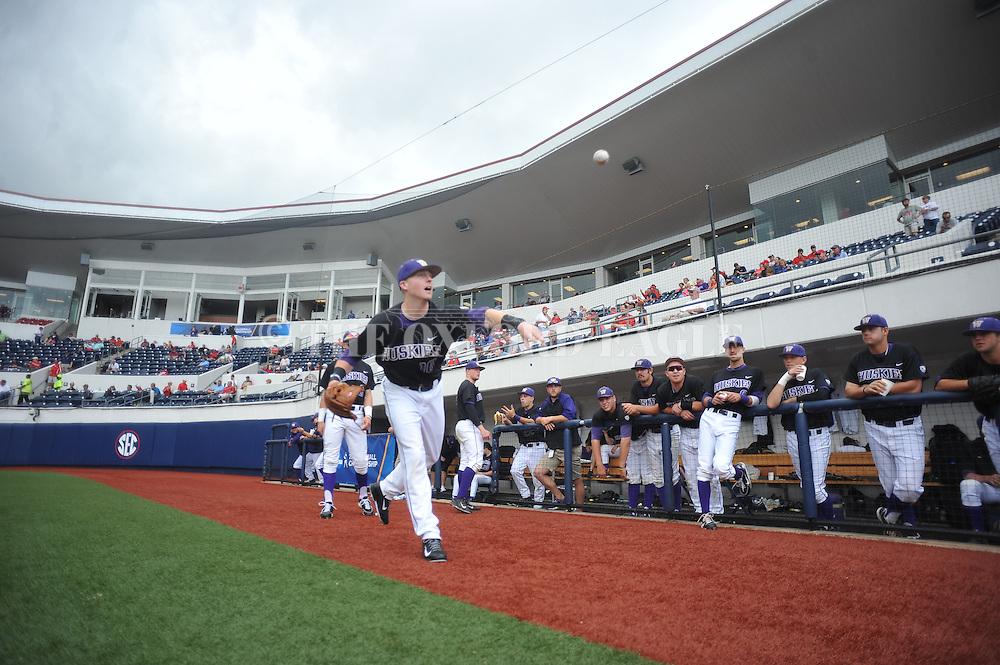 A rain delay before the Georgia Tech vs. Washington is waited out by Washington's Brian Wolfe (10) at the NCAA Oxford Regional at Oxford-University Stadium on Friday, May 30, 2014. (AP Photo/Oxford Eagle, Bruce Newman)