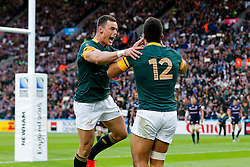South Africa Inside Centre Damian De Allende (R) celebrates with Outside Centre Jesse Kriel (L) after scoring the first try of the game - Mandatory byline: Rogan Thomson/JMP - 07966 386802 - 07/10/2015 - RUGBY UNION - The Stadium, Queen Elizabeth Olympic Park - London, England - South Africa v USA - Rugby World Cup 2015 Pool B.