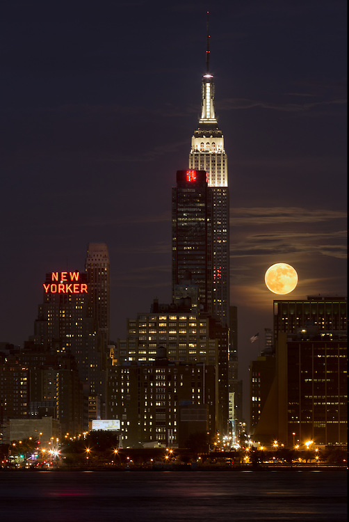 Supermoon rising over the Empire State Building in midtown Manhattan.