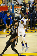 Golden State Warriors forward Draymond Green (23) drunks the ball against the San Antonio Spurs at Oracle Arena in Oakland, Calif., on October 25, 2016. (Stan Olszewski/Special to S.F. Examiner)