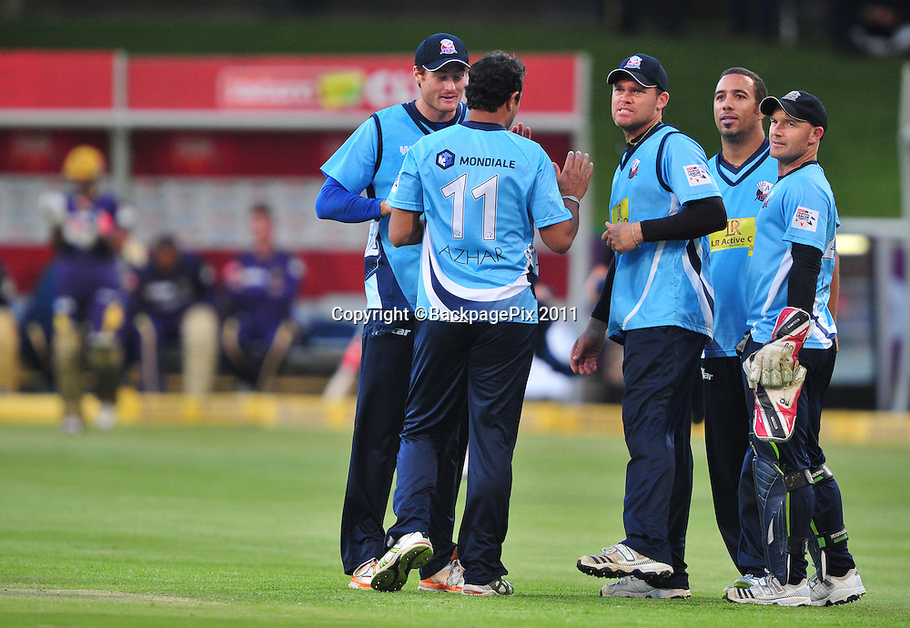 Azhar Mahmood of the Auckland Aces and his teammates celebrate the wicket of Jacques Kallis of the Kolkata Knight Riders during the 2012 Champions League Twenty20 cricket match between the Kolkata Knight Riders and the Auckland Aces at Newlands in Cape Town on 15 October 2012 ©Ryan Wilkisky/BackpagePix
