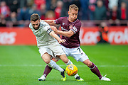 Graeme Shinnie (#3) of Aberdeen FC holds off Oliver Bozanic (#7) of Heart of Midlothian during the Ladbrokes Scottish Premiership match between Heart of Midlothian and Aberdeen at Tynecastle Stadium, Edinburgh, Scotland on 20 October 2018.