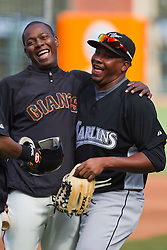 July 26, 2010; San Francisco, CA, USA;  San Francisco Giants shortstop Edgar Renteria (left) jokes with Florida Marlins starting pitcher Jorge Sosa (right) before the game at AT&T Park.  Florida defeated San Francisco 4-3.