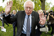 U.S. Senator Bernie Sanders (I-VT) is trailed by reporters at the end of a news conference outside the U.S. Capitol in Washington, April 30, 2015. Sanders, an independent from Vermont, launched his bid for the 2016 Democratic presidential nomination on the day before in a move likely to pressure Hillary Clinton from the left and challenge her on a range of fiscal issues from income inequality to corporate governance.
