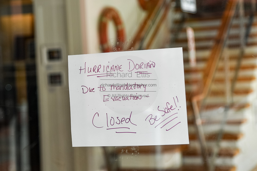 Charleston, South Carolina, USA. 03 September 2019. A closed sign on a store on King Street in the historic downtown in preparation for Hurricane Dorian September 3, 2019 in Charleston, South Carolina. The slow moving monster storm devastated the Bahamas and is expected to reach Charleston as a Category 2 by Thursday morning.