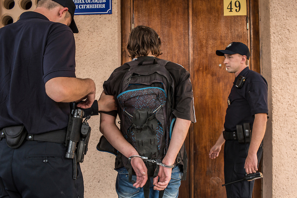LVIV, UKRAINE - SEPTEMBER 16, 2015: Members of the new Lviv police take Vladimir, 26, for a routine medical exam after arresting him when he was found intoxicated and sleeping in the city's central square and then swore at police officers in Lviv, Ukraine. In an effort to reform the notoriously corrupt Ukrainian police force, an entirely new force has been established in several cities, including Kiev and Lviv, with a primary focus on patrolling the streets. CREDIT: Brendan Hoffman for The New York Times