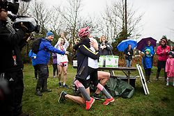 © Licensed to London News Pictures. 03/03/2019. Dorking, UK. Winners of the race CHRIS HEPWORTH hugs his partner TANISHA PRINCE after she accepted his marriage proposal at the finish line. Competitors take part in the 2019 annual Wife Carrying Race in Dorking, Surrey. Run over a course of 380m, with both men and women carry a 'wife' over obstacles, the race is believed to have originated in the UK over twelve centuries ago when Viking raiders rampaged into the northeast coast of England carrying off any unwilling local women . Photo credit: Ben Cawthra/LNP