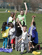 Middletown, New York - Children gather around a coach at the end of a soccer program at the Middletown YMCA on April 14, 2012.