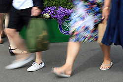 3 July 2017 -  Wimbledon Tennis (Day 1) - Motion blur of fans as they make their way among the planted flower containers - Photo: Marc Atkins / Offside.