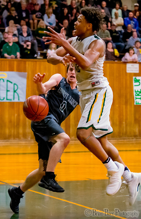 Liberty Ranch Hawks Chandler Garcia (0), fouls Placer Hillman Kai Huntsberry (10), during the third quarter as the Placer Hillman host the Liberty Ranch Hawks Varsity basketball team in the DIV NorCal boys quarterfinal, Saturday Mar 10, 2018.  <br /> photo by Brian Baer