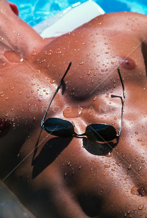 Man's Muscular  chest with sunglasses