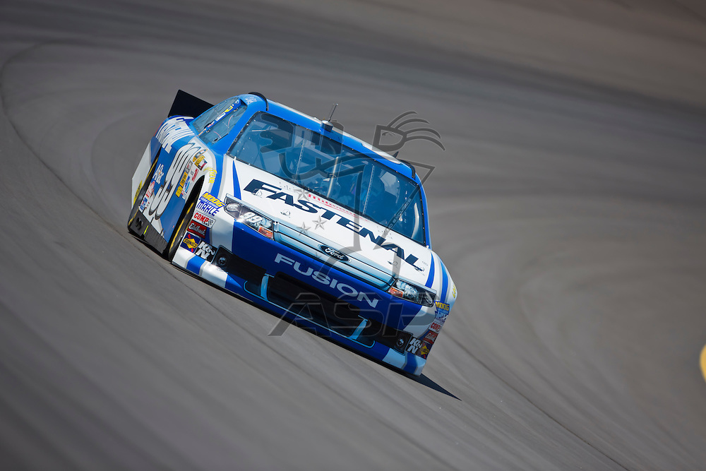 BROOKLYN, MI - JUN 14, 2012:  Carl Edwards (99) brings his car through the turns during the second test session for the Quicken Loans 400 at the Michigan International Speedway in Brooklyn, MI.