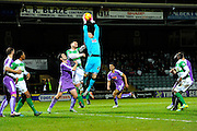 Plymouth Argyle goalkeeper Luke McCormick jumps to claim a cross into his box during the Sky Bet League 2 match between Yeovil Town and Plymouth Argyle at Huish Park, Yeovil, England on 23 February 2016. Photo by Graham Hunt.