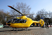 rescue helicopter surrounded by policemen