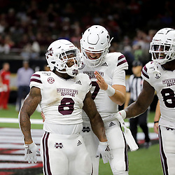 Aug 31, 2019; New Orleans, LA, USA; Mississippi State Bulldogs running back Kylin Hill (8) celebrates after a touchdown with quarterback Tommy Stevens (7) and tight end Farrod Green (82) during the second half against the Louisiana-Lafayette Ragin Cajuns at the Mercedes-Benz Stadium. Mandatory Credit: Derick E. Hingle-USA TODAY Sports