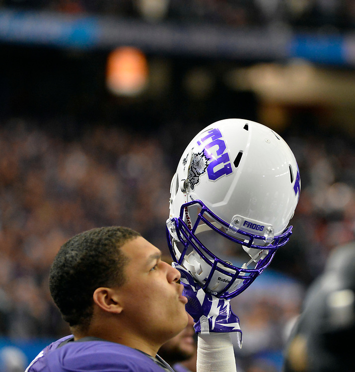 TCU Horned Frogs players cheer in the Ole Miss vs. TCU Chick-fil-A Peach Bowl football game at the Georgia Dome on December 31, 2014. David Tulis / Abell Images for the Chick-fil-A Bowl