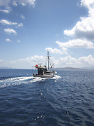 Fishing boat on tour to an island near Kalymnos in the Aegean Sea, Greece.
