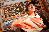 Fish monger, Kara Lunde, at the Alaska Fish House,  Ketchikan, Alaska