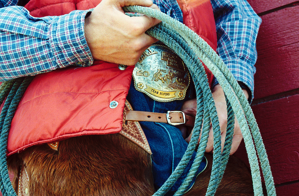 Cowboy Roper stands with his Rope, Trophy Belt Buckle, Alberta Canada