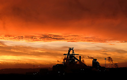 © Licensed to London News Pictures. <br /> 07/01/2015. <br /> <br /> South Gare, Teesside<br /> <br /> A beautiful dawn spreads out over the steel works at South Gare near Redcar on Teesside.<br /> <br /> Photo credit : Ian Forsyth/LNP