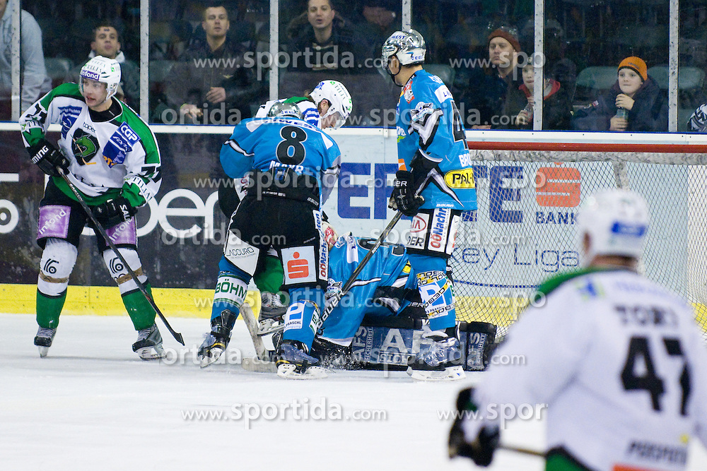 Lorenz Hirn (EHC Liwest Black Wings Linz, #33) covers a puck during ice-hockey match between HDD Tilia Olimpija and EHC Liwest Black Wings Linz in 37th Round of EBEL league, on Januar 9, 2011 at Hala Tivoli, Ljubljana, Slovenia. (Photo By Matic Klansek Velej / Sportida.com)