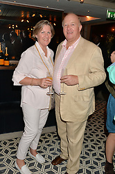 DEREK & COLETTE CONWAY at Henry Conway's 31st birthday party held at the Pont St Restaurant, Belgraves Hotel, London on 12th July 2014.