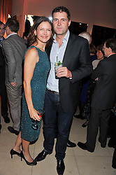 KATIE DERHAM and her husband JOHN VINCENT at the Costa Book Awards 2012 held at Quaglino's, 16 Bury Street, London SW1 on 29th January 2013.