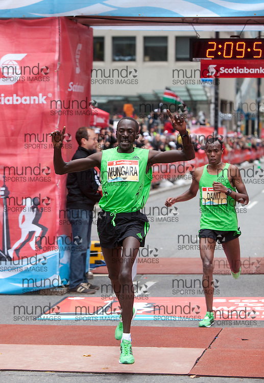 Toronto, Ontario ---11-10-16--- Kenneth Mungara celebrates as he edges out Shami Abdulahi Dawit at the finish line of the Scotiabank Toronto Waterfront Marathon, October 16, 2011..GEOFF ROBINS Mundo Sport Images