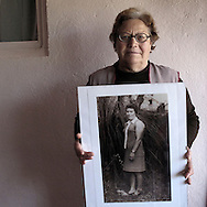 Woman showing old portrait in Valtuilla de Arriba, Leon province . Spain . The WAY OF SAINT JAMES or CAMINO DE SANTIAGO following the French Route, between Saint Jean Pied de Port and Santiago de Compostela in Galicia, SPAIN. Tradition says that the body and head of St. James, after his execution circa. 44 AD, was taken by boat from Jerusalem to Santiago de Compostela. The Cathedral built to keep the remains has long been regarded as important as Rome and Jerusalem in terms of Christian religious significance, a site worthy to be a pilgrimage destination for over a thousand years. In addition to people undertaking a religious pilgrimage, there are many travellers and hikers who nowadays walk the route for non-religious reasons: travel, sport, or simply the challenge of weeks of walking in a foreign land. In Spain there are many different paths to reach Santiago. The three main ones are the French, the Silver and the Coastal or Northern Way. The pilgrimage was named one of UNESCO's World Heritage Sites in 1993. When there is a Holy Compostellan Year (whenever July 25 falls on a Sunday; the next will be 2010) the Galician government's Xacobeo tourism campaign is unleashed once more. Last Compostellan year was 2004 and the number of pilgrims increased to almost 200.000 people.