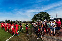 the teams of Go Ahead Eagles and Excelsior enter the pitch during the Friendly match between Go Ahead Eagles and Excelsior Rotterdam at sportcomplex SV Terwolde on July 20, 2018 in Terwolde, The Netherlands