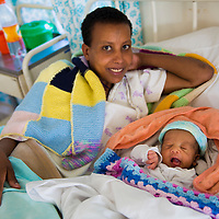 Yeninesh (mother) with Tsegye (baby) from Gotcham in Tingabre kebede village