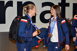 Pictured is Lizzy Yarnold (left) who won a gold medal in the Woman's Skeleton and Eve Muirhead (right)who won a bronze medal in the Woman's Curling.<br /> Team GB Return from the Sochi 2014 Olympic Winter Games to Heathrow Airport, London, UK.<br /> Monday, 24th February 2014. Picture by Ben Stevens / i-Images