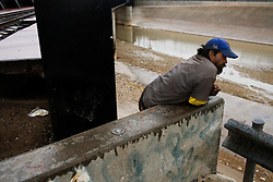 A homeless drug addict relaxes near the Rio Grande river that separates El Paso, Texas and Ciudad Juarez, Mexico.  Mexico is undergoing a violent war with the nation's drug cartels and Ciudad Juarez has become the murder capital of Mexico, with over 4,000 murders in the past two years.  President Felipe Calderon has dispatched thousands of soldiers and federal police officers in order to contain the situation, but they have not been successful.