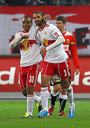 11.12.2011, Stadion, Salzburg, Red Bull Arena, AUT, 1. FBL, RB Salzburg vs FC Trenkwalder Admira Wacker, im Bild Siegesjubel Leonardo, (Red Bull Salzburg, #30)  Douglas da Silva, (Red Bull Salzburg, #3)  during the Austrian Bundesliga Match, RB Salzburg against FC Trenkwalder Admira Wacker, Stadium, Red Bull Arena near Salzburg, Austria on 2011-12-11, EXPA Pictures © 2011, PhotoCredit: EXPA/ S. Woldron