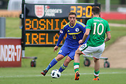 Nemanja Nikolic of Bosnia and Herzegovina (13) takes on Troy Parrot of Republic of Ireland (10) during the UEFA European Under 17 Championship 2018 match between Bosnia and Republic of Ireland at Stadion Bilino Polje, Zenica, Bosnia and Herzegovina on 11 May 2018. Picture by Mick Haynes.
