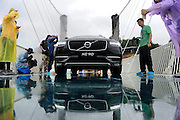 ZHANGJIAJIE, CHINA - JUNE 25:<br /> <br />  A car drives over glass-bottomed bridge for a safety test at Zhangjiajie Grand Canyon on June 25, 2016 in Zhangjiajie, Hunan Province of China. World\'s tallest and longest glass-bottomed bridge has been completed and took a global broadcast through television and internet medias to show its safety. More than thirty citizens and visitors thumped the bridge with hammer in the test event. ©Exclusivepix Media
