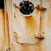 Rusty door on an aging fishing trawler, Gloucester, MA