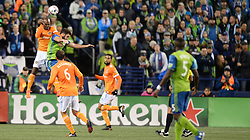 November 30, 2017 - Seattle, Washington, U.S - Soccer 2017: Houston's ADOLFO MACHADO (3) and Seattle forward WILL BRUIN (17) battle for the ball as the Houston Dynamo play the Seattle Sounders in the 2nd leg of the MLS Western Conference Finals match at Century Link Field in Seattle, WA. (Credit Image: © Jeff Halstead via ZUMA Wire)