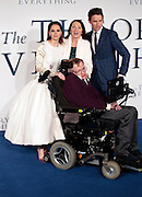 """Dec 9, 2014 - """"The Theory Of Everything"""" - UK Premiere - Red Carpet Arrivals at Odeon,  Leicester Square, London<br /> <br /> Pictured:  Professor Stephen Hawking; Eddie Redmayne; Felicity Jones<br /> ©Exclusivepix Media"""