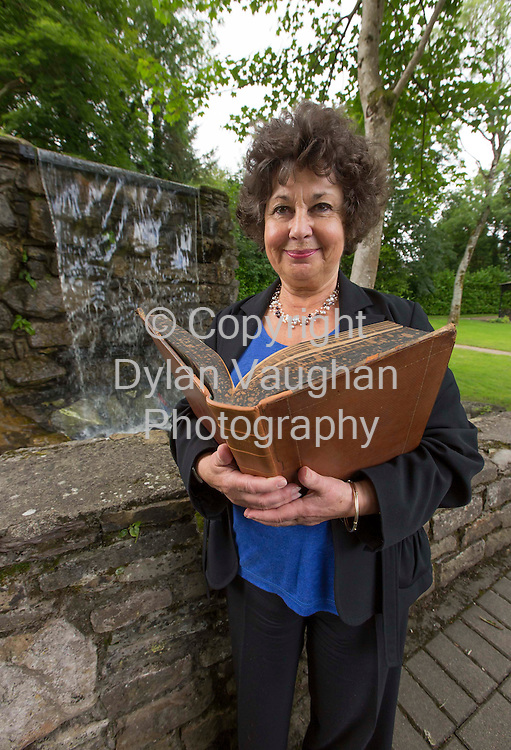 17/7/2012.Ingrid Hook pictured yesterday with a copy of Boyles Works Volume 3 printed in London in 1772 at the Robert Boyle Summer School in Lsimore Co Waterford..Picture Dylan Vaughan.