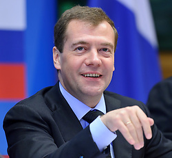 "Dmitry Medvedev, Russia's president, gestures during the EU-Russia summit at the European Union council headquarters in Brussels, Belgium, on Tuesday, Dec. 7, 2010. Russia will move a step closer to membership in the World Trade Organisation today when it signs an agreement with the European Union settling ""key questions"" that have hampered its accession bid for years. (Photo © Jock Fistick)."