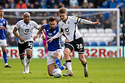 George Byers of Swansea City is tackled by Marlon Pack of Cardiff City during the EFL Sky Bet Championship match between Cardiff City and Swansea City at the Cardiff City Stadium, Cardiff, Wales on 12 January 2020.