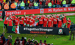 CARDIFF, WALES - Tuesday, October 13, 2015: Wales players celebrate after qualifying for the finals following a 2-0 victory over Andorra during the UEFA Euro 2016 qualifying Group B match at the Cardiff City Stadium. David Cotterill, Jonathan Williams, Aaron Ramsey, Joe Ledley, Chris Gunter, Gareth Bale, Aaron Ramsey, goalkeeper Daniel Ward, Neil Taylor, Sam Vokes, Andy King, Emyr Huws, Ben Davies, Tom Lawrence, Sam Vokes, James Chester, Ashley 'Jazz' Richards, goalkeeper Owain Fon Williams, James Collins, David Edwards, goalkeeper Owain Fon Williams. (Pic by Paul Currie/Propaganda)