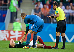 MOSCOW, RUSSIA - Sunday, June 17, 2018: Mexico's Javier Hernandez lies injured as Germany's goalkeeper Manuel Neuer tries to pick him up during the FIFA World Cup Russia 2018 Group F match between Germany and Mexico at the Luzhniki Stadium. (Pic by David Rawcliffe/Propaganda)