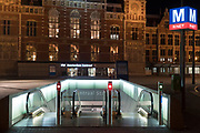 Metro entrance with the Amsterdam Central Station building Netherlands.