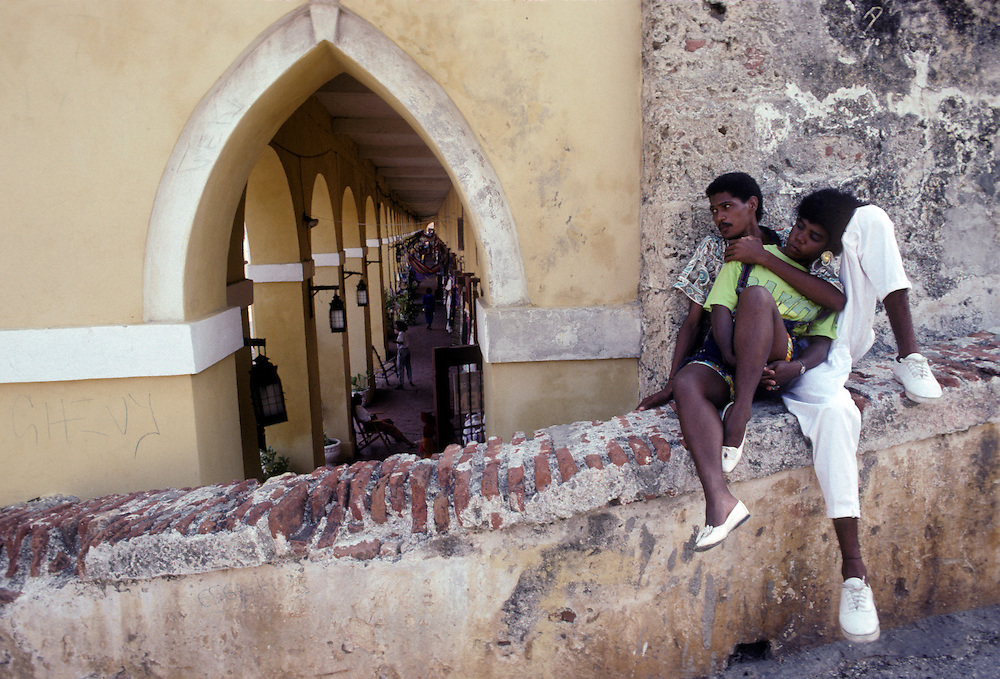 Lovers embrace on the ramparts by the old jail cells, Cartagena, Colombia.