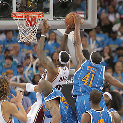 01 November 2008:  New Orleans Hornets forward James Posey (41) is called for a foul on a blocked shot attempt by Cleveland Cavaliers forward LeBron James (23) during a 104-92 win by the New Orleans Hornets over the Cleveland Cavaliers at the New Orleans Arena in New Orleans, LA..
