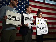 "31 OCTOBER 2019 - DES MOINES, IOWA: People protest against changes to the Affordable Care Act in the Neil Smith Federal Building in Des Moines. A small crowd of people came to the federal building, where US Senators Chuck Grassley's (R-IA) and Joni Ernst's (R-IA) offices are, to deliver a petition protesting the Senate's vote that critics say would allow ""spooky junk health insurance plans"" with limited coverage and would allow insurance companies to deny coverage to people with pre-existing conditions.            PHOTO BY JACK KURTZ"